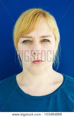 Portrait Of Young Blond Woman Looking Angry