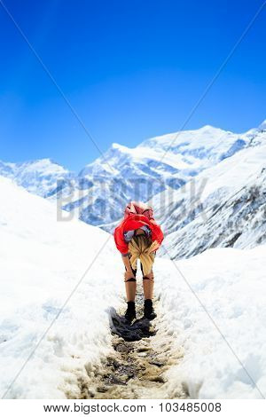 Tired Woman Climbing And Hiking In Winter Mountains