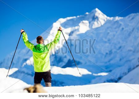 Successful Man Accomplish Hiker with arms outstretched in high Himalaya Mountains in Nepal. Happy hi