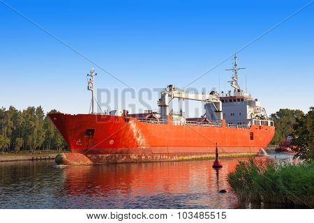 Cargo Ship With Tug Boat