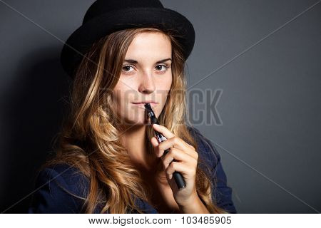 Elegant Woman Smoking E-cigarette Wearing Suit And Hat