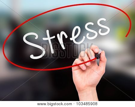 Man Hand writing Stress with marker on transparent wipe board.