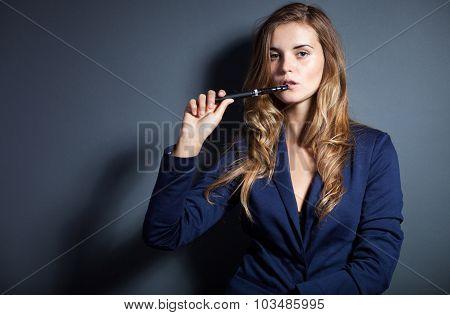 Elegant Woman Smoking E-cigarette Wearing Suit