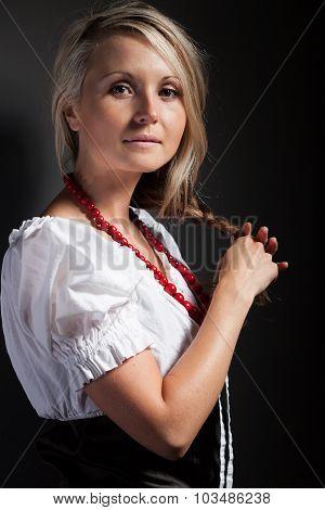 Folk Woman In Folklore Clothes Braiding A Plait