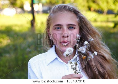 Young Girl And Dandelion