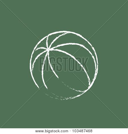Beach ball hand drawn in chalk on a blackboard vector white icon isolated on a green background.