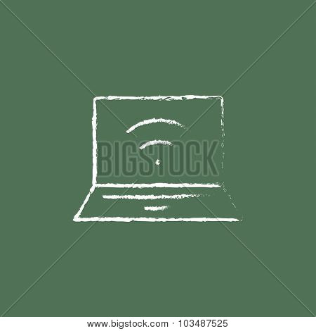 Laptop with wifi sign hand drawn in chalk on a blackboard vector white icon isolated on a green background.