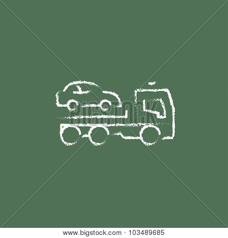Car towing truck hand drawn in chalk on a blackboard vector white icon isolated on a green background.