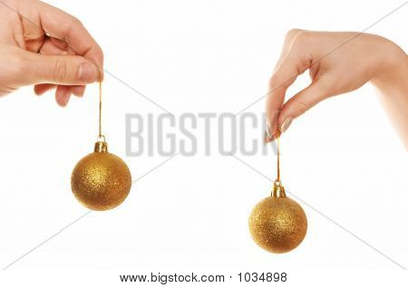 Hands Holding Christmas Balls