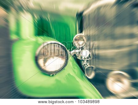 Close Up Of A Vintage Retro Classic Car - Vintage Filtered Look With Popped Up Green Color