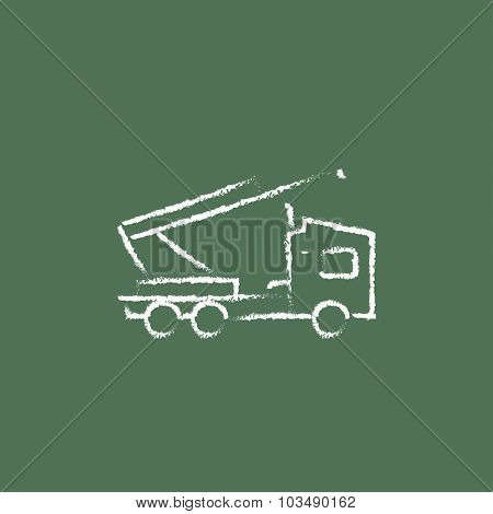 Machine with a crane hand drawn in chalk on a blackboard vector white icon isolated on a green background.