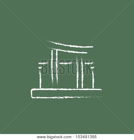 Torii gate hand drawn in chalk on a blackboard vector white icon isolated on a green background.