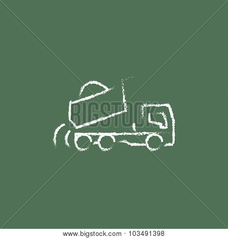 Dump truck hand drawn in chalk on a blackboard vector white icon isolated on a green background.