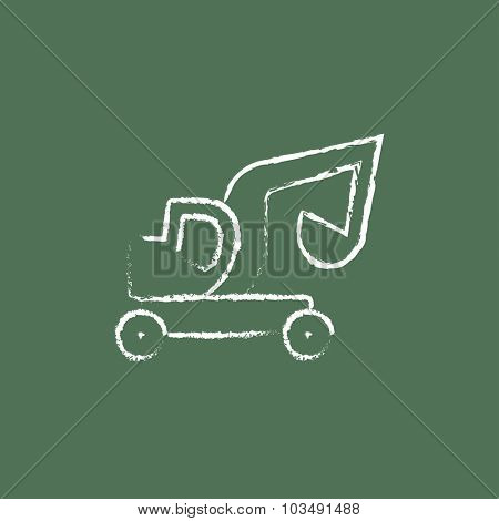 Excavator truck hand drawn in chalk on a blackboard vector white icon isolated on a green background.