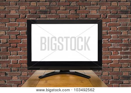 Modern television with red brick with cut out screen.