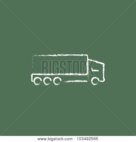 Delivery truck hand drawn in chalk on a blackboard vector white icon isolated on a green background.