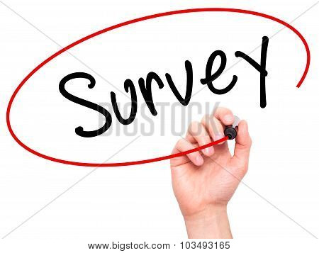 Man Hand writing Survey with marker on transparent wipe board.