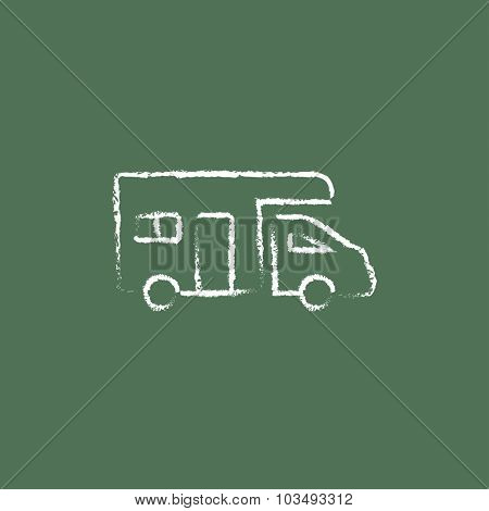 Camper van hand drawn in chalk on a blackboard vector white icon isolated on a green background.
