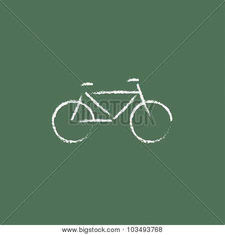 Bicycle hand drawn in chalk on a blackboard vector white icon isolated on a green background.