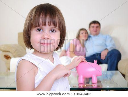 little girl hides her money