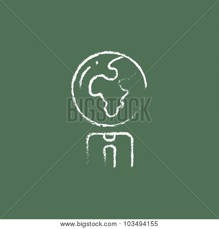 Human with globe head hand drawn in chalk on a blackboard vector white icon isolated on a green background.
