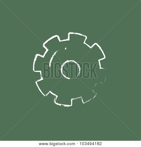 Gear hand drawn in chalk on a blackboard vector white icon isolated on a green background.