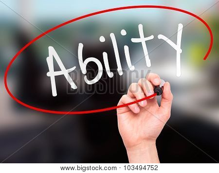 Man Hand writing Ability with marker on transparent wipe board.