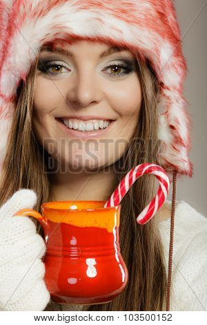 Winter Woman Holds Red Mud