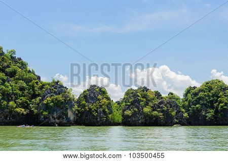 Mountain Forest And Sea Water On White Cloud On Blue Sky