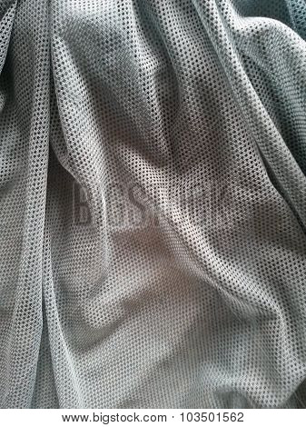 Grey Fishnet Fabric Background