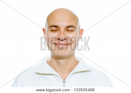 Bald Smiling Man With His Eyes Closed. Isolated. Studio