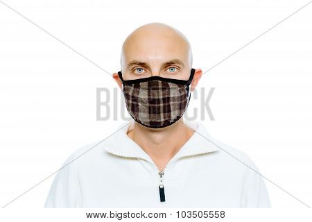 Bald, Man In A White Jacket And Mask. Studio. Isolated