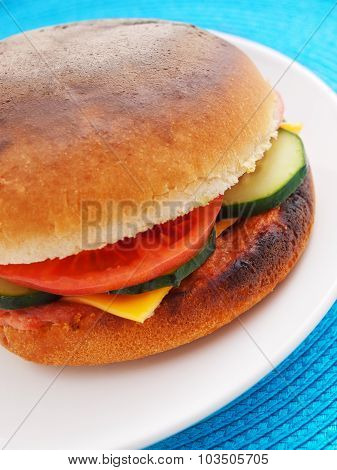 Cheeseburger With Tomato And Cucumber
