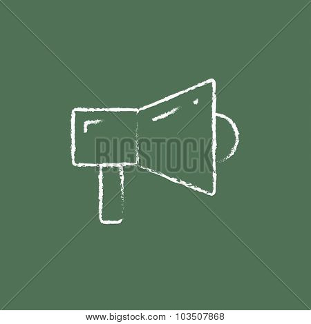 Megaphone hand drawn in chalk on a blackboard vector white icon isolated on a green background.