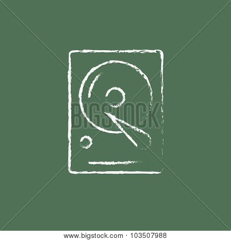 Hard disk hand drawn in chalk on a blackboard vector white icon isolated on a green background.