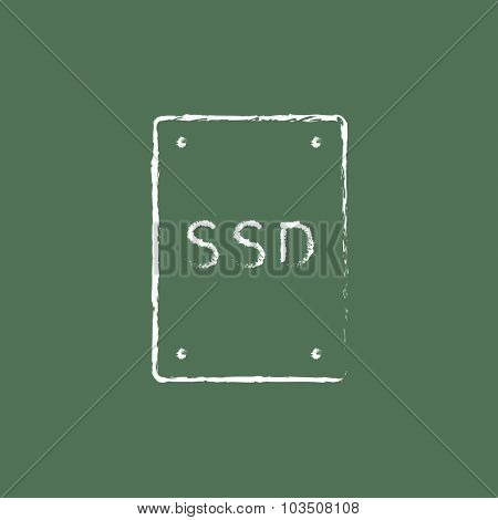 Solid state drive hand drawn in chalk on a blackboard vector white icon isolated on a green background.