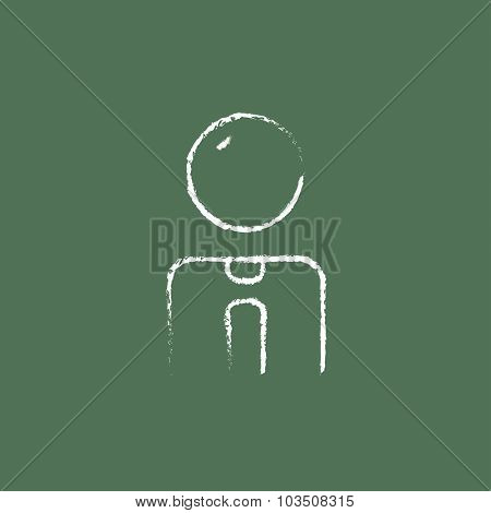 Businessman hand drawn in chalk on a blackboard vector white icon isolated on a green background.