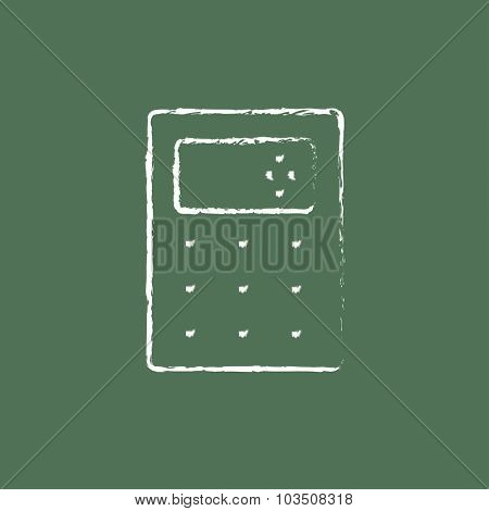 Calculator hand drawn in chalk on a blackboard vector white icon isolated on a green background.