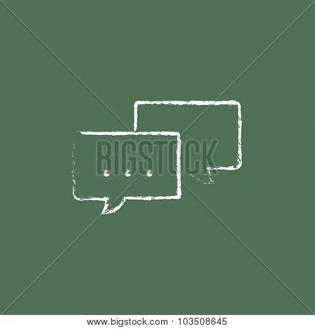 Speech squares hand drawn in chalk on a blackboard vector white icon isolated on a green background.