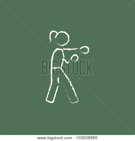 Female boxer hand drawn in chalk on a blackboard vector white icon isolated on a green background.