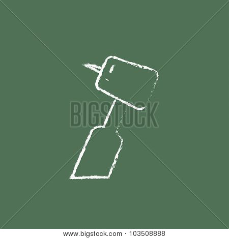 Dental drill hand drawn in chalk on a blackboard vector white icon isolated on a green background.