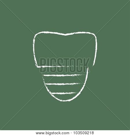 Tooth implant hand drawn in chalk on a blackboard vector white icon isolated on a green background.