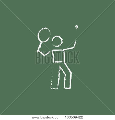 Tennis player hand drawn in chalk on a blackboard vector white icon isolated on a green background.