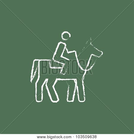 Horse riding hand drawn in chalk on a blackboard vector white icon isolated on a green background.