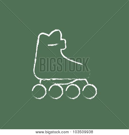 Roller skate hand drawn in chalk on a blackboard vector white icon isolated on a green background.