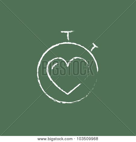 Stopwatch with heart hand drawn in chalk on a blackboard vector white icon isolated on a green background.