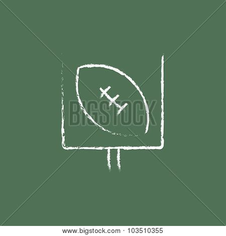 Gate and ball for rugby hand drawn in chalk on a blackboard vector white icon isolated on a green background.