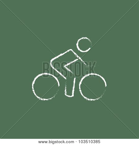 Sports bike and cyclist hand drawn in chalk on a blackboard vector white icon isolated on a green background.