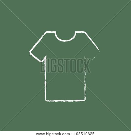 T-shirt hand drawn in chalk on a blackboard vector white icon isolated on a green background.