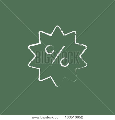Discount tag hand drawn in chalk on a blackboard vector white icon isolated on a green background.